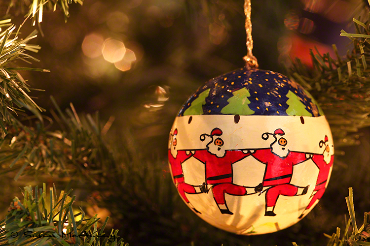 Hand painted holiday ornamental ball